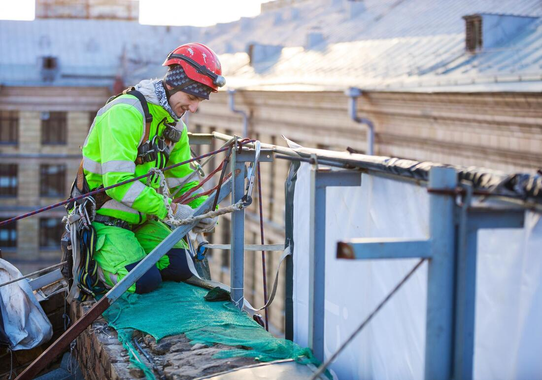 commercial roofing worker working