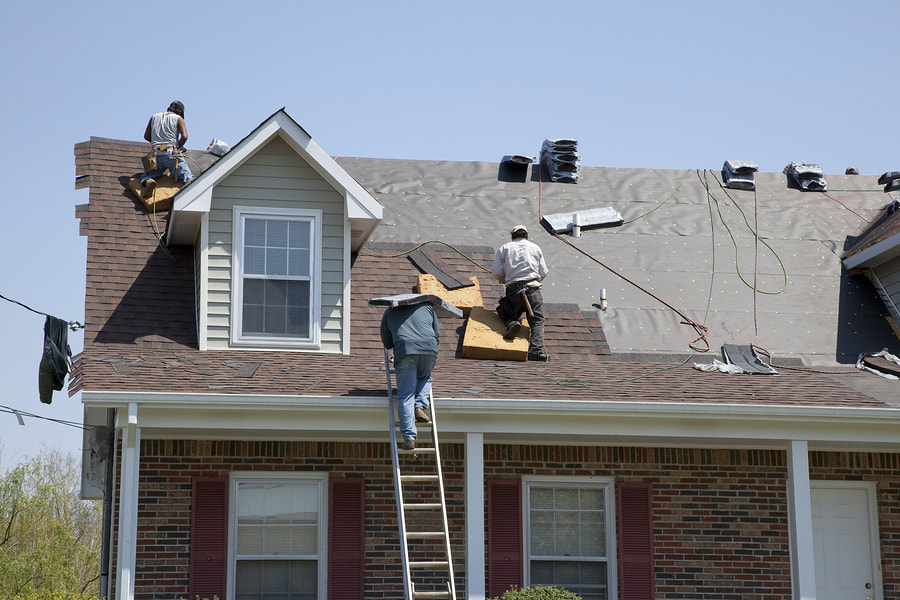 construction workers doing re-roofing