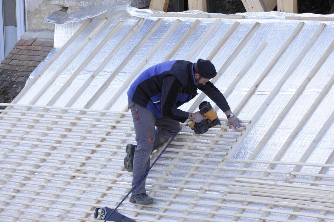 construction worker installing roof